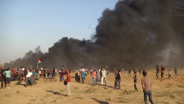 "various shots as palestinians burn tires during the 26th friday of ""great march of return"" demonstration near israel-gaza border, in rafah, gaza on... - 2018 gaza border protests stock videos & royalty-free footage"