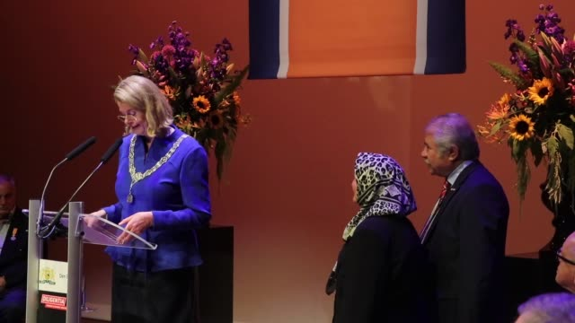various shots as turkish woman zehra turker at 82yearold is decorated with dutch royal order by hague mayor pauline krikke during the ceremony due to... - the hague stock videos and b-roll footage