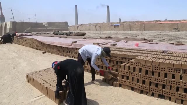 various shots as women mudbrick workers manufacture adobe in iraqi capital baghdad on july 22 2019 two of workers speak to the press - adobe stock videos & royalty-free footage