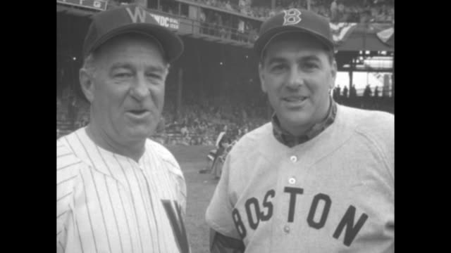 Various shots MS Boston Red Sox manager Lou Boudreau and Washington Senators manager Bucky Harris shaking hands people in stands at stadium in bg on...