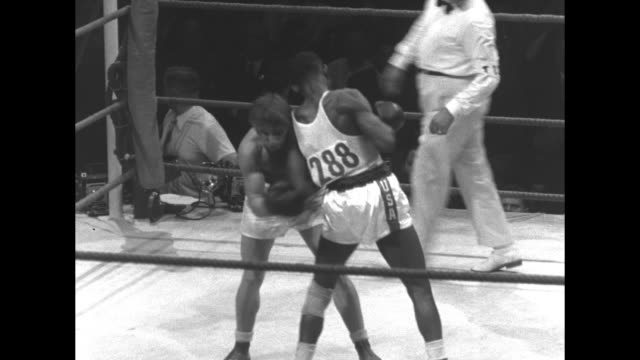 various shots boxing match between american chuck adkins and soviet viktor mednov in ring with referee; referee calls fight in favor of adkins who... - former soviet union stock videos & royalty-free footage