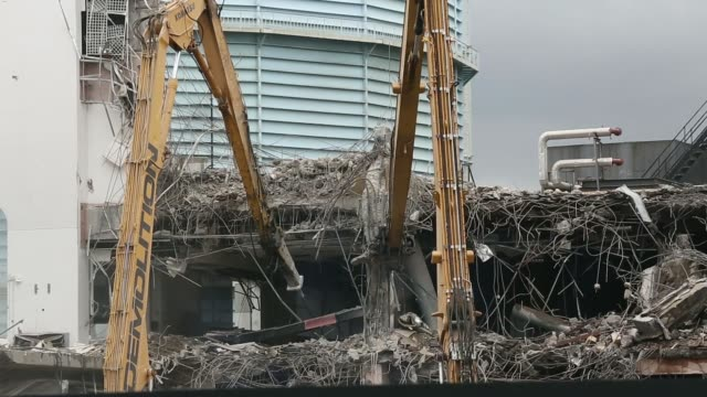 Various shots bulldozers working on the demolition of Marco Polo House at the site of a new Berkeley Homes development called Vista in London UK on...