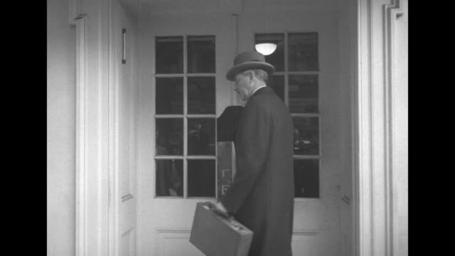 various shots cabinet members and military advisors arrive at white house to consider dropping atomic bomb to end korean war / secretary of defense... - joint chiefs of staff stock videos and b-roll footage