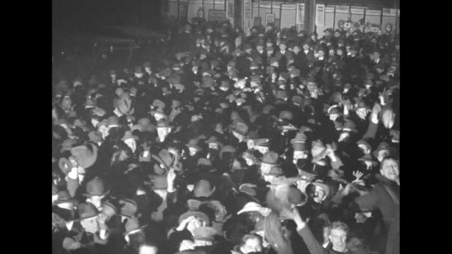 various shots crowd of excited men at night waving at camera / birdseye view lighted area with crowd moving / men and movie camera atop moving... - 1910 stock videos & royalty-free footage