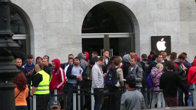 various shots customers queue before the sales launch of the iphone 6 and iphone 6 plus outside the apple inc store in berlin germany on friday sept... - launch event stock videos & royalty-free footage