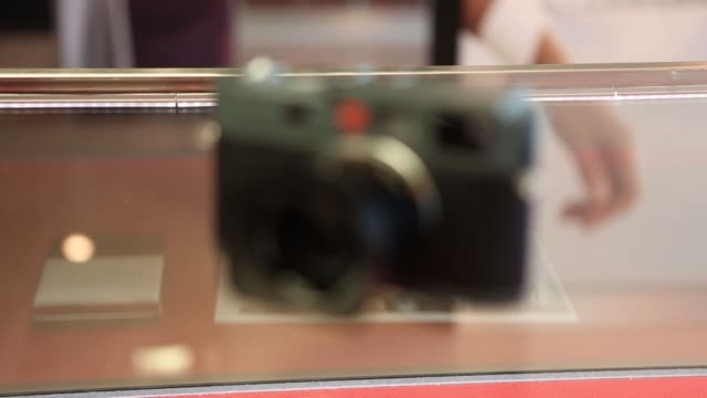 various shots different models of leica cameras positioned on a glass worktop at the leica camera ag headquarters in solms, germany, on wednesday,... - digital camera stock videos & royalty-free footage