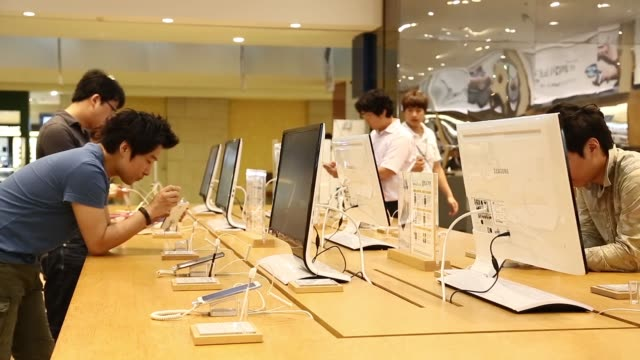 various shots employees help customers at the counter at the samsung electronics co flagship store in seoul south korea on wednesday sept 25... - variation stock videos & royalty-free footage