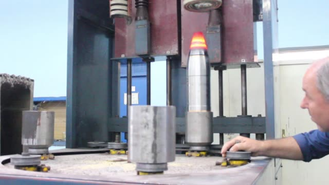 various shots employees operate machinery during munitions assembly at the state run sloboda ad ammunitions plant in cacak, serbia, on wednesday,... - serbia stock videos & royalty-free footage