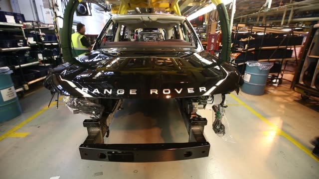 various shots employees work on range rover sport automobiles as they move along the assembly line at the jaguar land rover plc plant in solihull uk... - plc stock videos & royalty-free footage