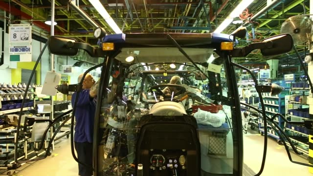 various shots employees work on the cabs of holland tractors on the production line at cnh industrial nvs assembly plant in basildon, uk, on... - basildon stock-videos und b-roll-filmmaterial