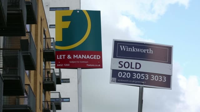Various shots estate agents Sold For Sale and Let signs stand outside a residential apartment block in the suburb of Greenwich in London UK on...