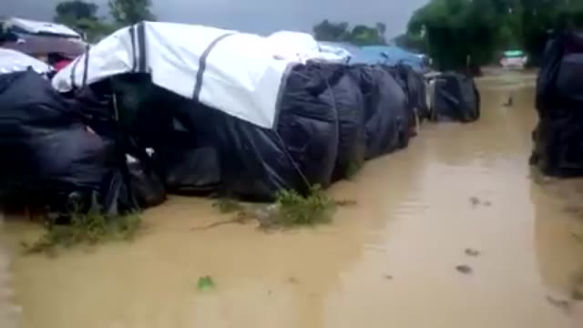 Various shots from a Rohingya refugee camp hit by monsoon rains in Cox's Bazar Bangladesh on June 13 2018