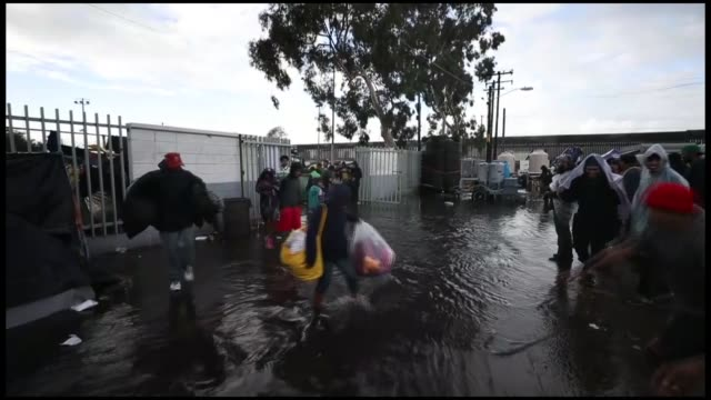 various shots from a temporary shelter set up for members of the 'migrant caravan' on november 30 2018 in tijuana mexico rains today in tijuana... - tijuana stock videos & royalty-free footage