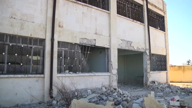 various shots from destroyed school after the war crafts belonging to the syrian army carried out airstrike over residential areas at khan alasal... - ruined stock videos & royalty-free footage