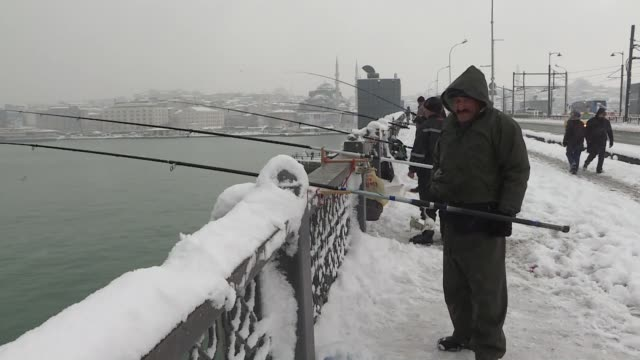 various shots from istanbul during a heavy snowfall on january 09 2017 extreme winter conditions continue to take a toll on daily life in istanbul... - yeni cami mosque stock videos and b-roll footage