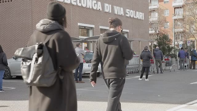 vídeos de stock, filmes e b-roll de various shots from italy's milan on march 13 people as they wait outside supermarkets before they start shopping long queues formed outside markets... - ciampino airport