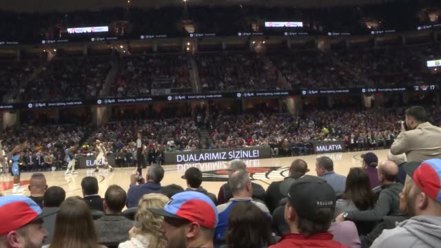 "various shots from nba match, indicating commercial panels reading in turkish ""dualarimiz sizinle elazig and malatya!"" in english ""our prayers are... - match sport stock videos & royalty-free footage"