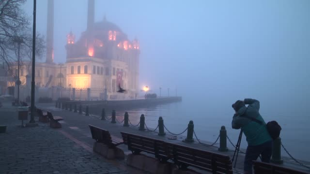 various shots from ortakoy mosque bosphorus strait and july 15 martyrs' bridge covered by dense morning fog on march 11 2018 in istanbul turkey - bosphorus stock videos & royalty-free footage