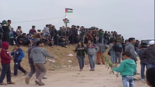 various shots from palestinians in the blockaded gaza strip on march 30 2018 who start to converge on the strip's eastern border with israel where... - historical palestine stock videos & royalty-free footage