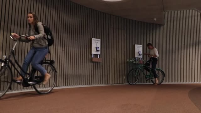 various shots from parking garage for cyclists which has been officially opened in the netherlands' utrecht the biggest facility of its kind in the... - utrecht stock videos and b-roll footage