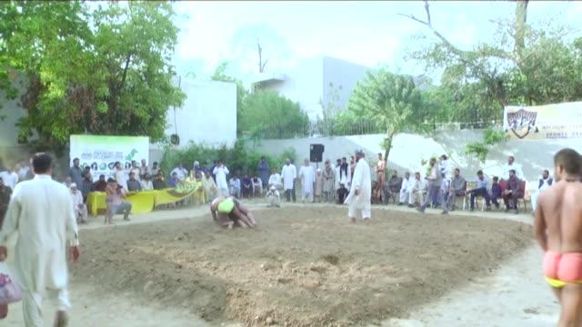 various shots from pehlwans at the pehlwani akhara wrestling pit in a corner of liaquat bagh in rawalpindi city of pakistan on april 06 2018... - punjab pakistan bildbanksvideor och videomaterial från bakom kulisserna