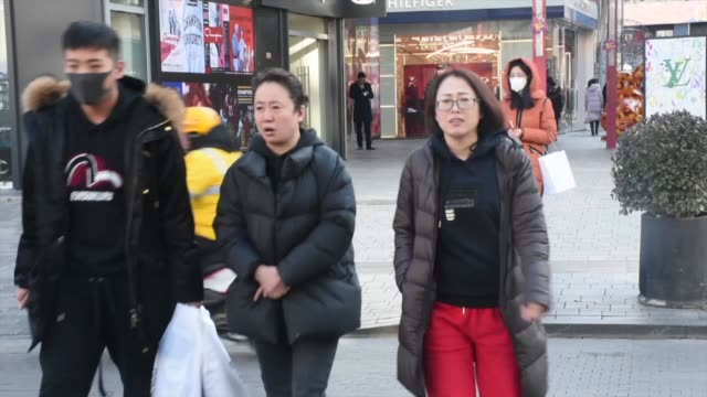 various shots from people wearing protective face masks in beijing on january 23 2020 the death toll from the outbreak of a new respiratory virus in... - north korea stock videos & royalty-free footage