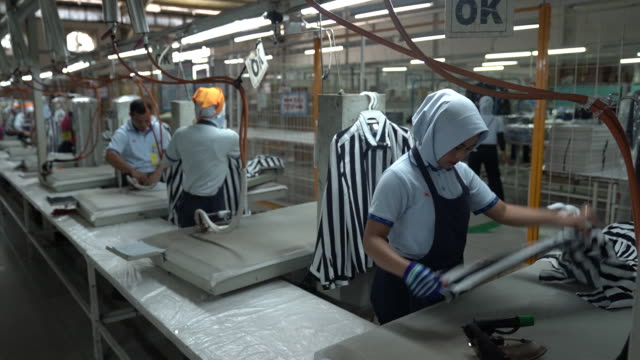 various shots from sri rejeki isman pt factory in solo java indonesia on friday september 27 2019 sri rejeki isman known as sritex makes apparel for... - iron appliance stock videos & royalty-free footage