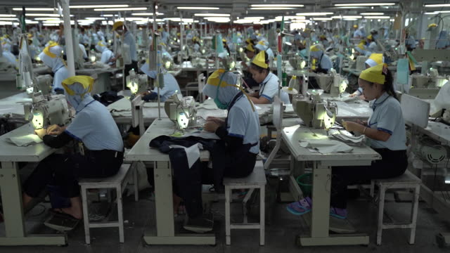 various shots from sri rejeki isman pt factory in solo java indonesia on friday september 27 2019 sri rejeki isman known as sritex makes apparel for... - textile stock videos & royalty-free footage
