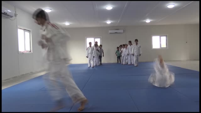various shots from turkish imam yusuf yoldas who performs his duty at mosque in southeastern diyarbakir province in one hand while he trainsjudo to... - 柔道点の映像素材/bロール