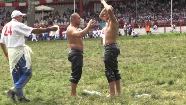 Various shots from wrestlers competing on the second day competition of the 656th Kirkpinar oil wrestling festival at contest field in Edirne Turkey...