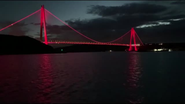 various shots from yavuz sultan selim bridge which is illuminated with azerbaijani flag colors marking the 101st anniversary of the republic day of... - yavuz sultan selim bridge stock videos & royalty-free footage
