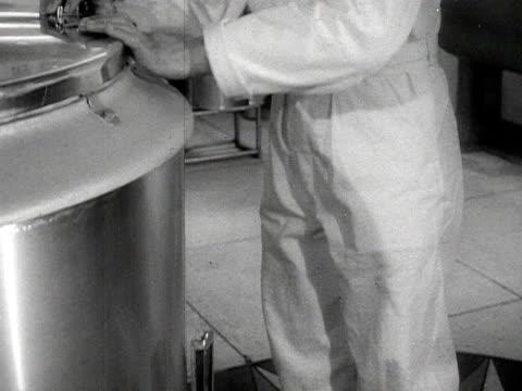various shots inside an ice cream parlour men use machines to churn ice cream - cibi surgelati video stock e b–roll