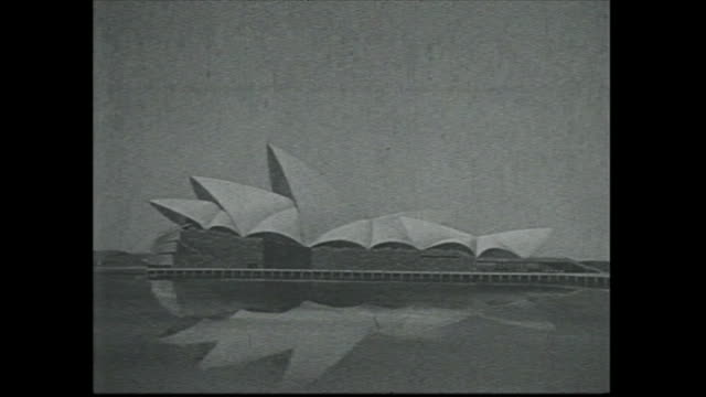 Various shots Jorn Utzon's entries in the Sydney Opera House Design Competition on display / People viewing various images of the Opera House designs...