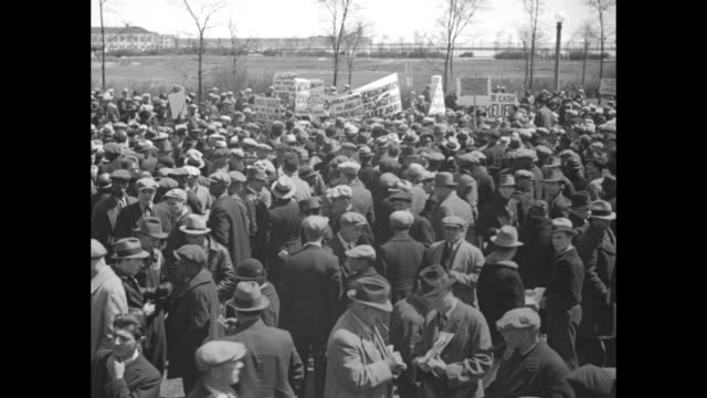 """various shots large outdoor gathering of jobless, many hold up signs / closer shot participants, can see large banner reading """"chicago workers... - labor union stock videos & royalty-free footage"""