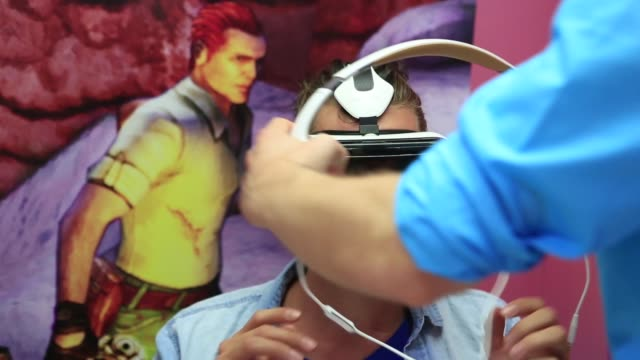 Various shots male visitors try out Samsung Gear VR virtual reality headsets developed jointly by Oculus VR Inc and Samsung Electronics Co IFA...