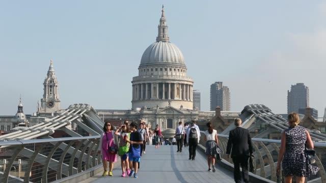 commuters on the millennium bridge in london - pedestrian stock videos & royalty-free footage