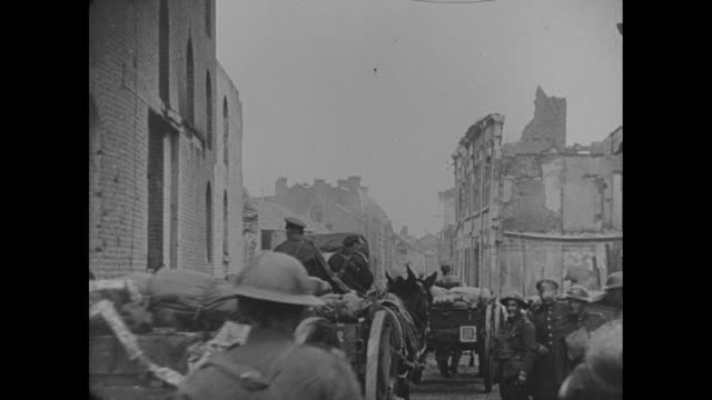 various shots of a british military band followed by armed soldiers marching into bad bergzabern germany as children dance and adults applaud / mule... - 1910 1919 stock videos and b-roll footage