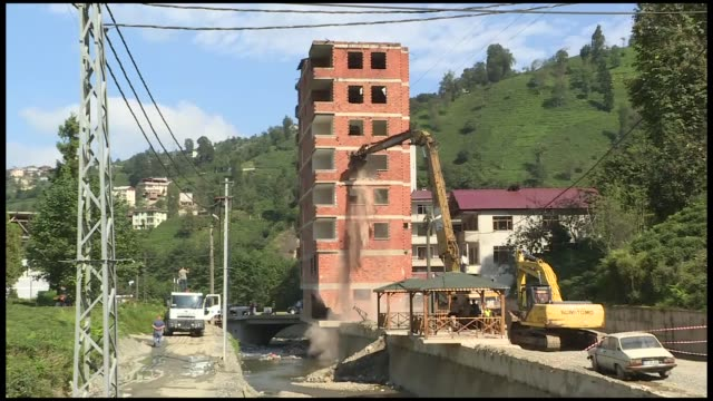 Various shots of a bulldozer demolishing a 7storey building in Rize northern province of Turkey on October 03 2018 Demolition of the building is on...