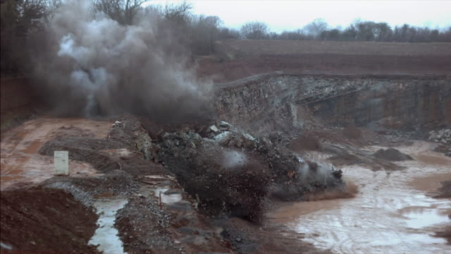 Various shots of a controlled explosion in a quarry