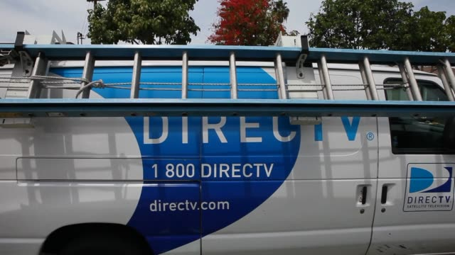 various shots of a directv installation service truck with signage painted on the side in lynwood california a directv technician loads a ladder onto... - satellite tv stock videos and b-roll footage
