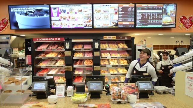 various shots of a dunkin donuts inc store in manhattan new york us on wednesday feb 5 a tight shot of a young female employee waits on customers at... - hold me tight stock videos & royalty-free footage