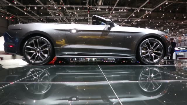 various shots of a silver ford mustang at the 2014 geneva motor show in geneva switzerland on march 5 a side profile shot of a silver ford mustang on... - ford mustang stock videos and b-roll footage