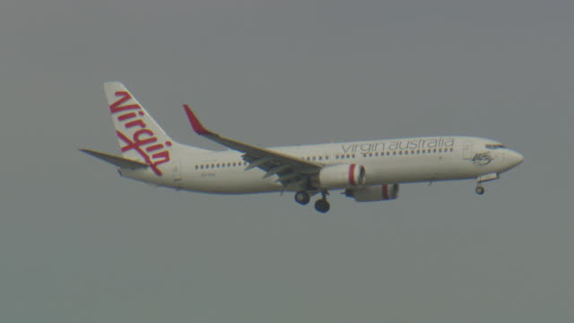 various shots of a virgin australia planes taking off taxiing and flying - taxiing stock videos & royalty-free footage
