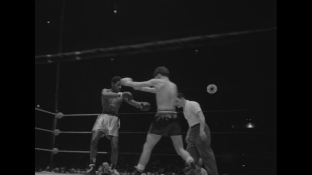 various shots of amateur boxing matches / gv madison square garden arena with boxing ring and spectators watching match /spectators / various shots... - hands on stomach stock videos & royalty-free footage