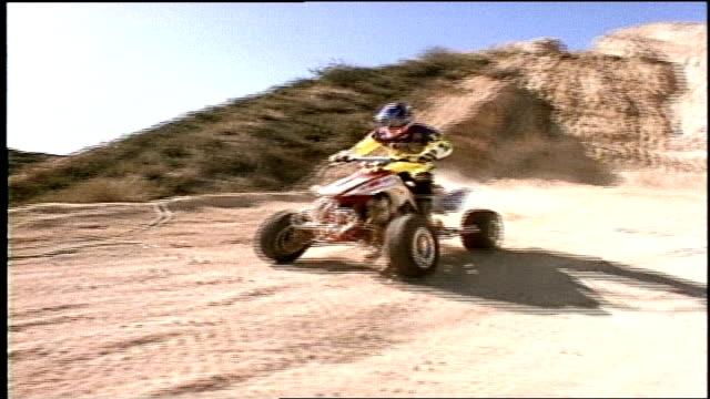 various shots of atv riding past camera - quadbike stock videos & royalty-free footage