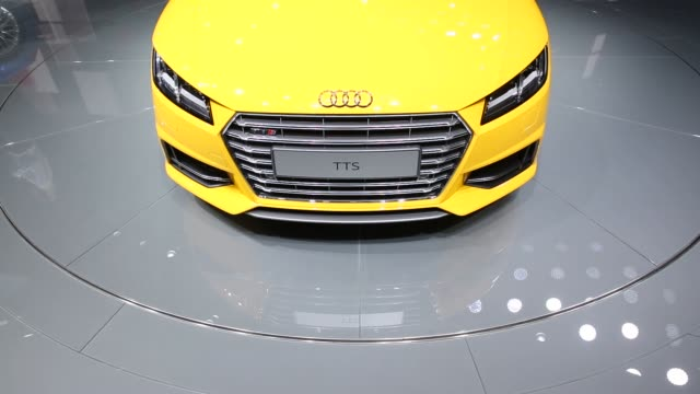 Various shots of Audi automobiles on display at the 2014 Paris Motor Show in Paris France Close up shots of a yellow Audi convertible Handheld shot...