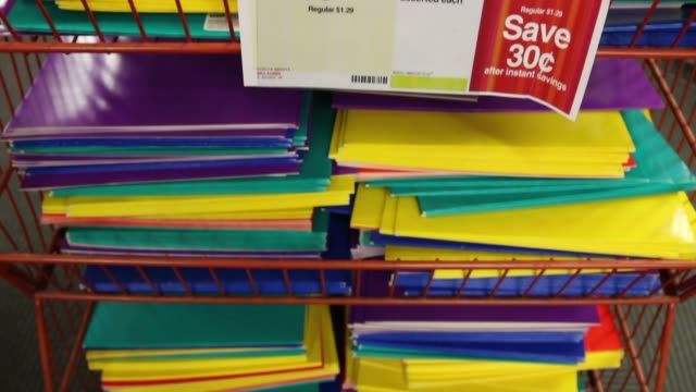 vídeos y material grabado en eventos de stock de various shots of back to school products at a staples retail location in manhattan new york a medium shot of stacks of notebooks and folders a tight... - carpeta de anillas