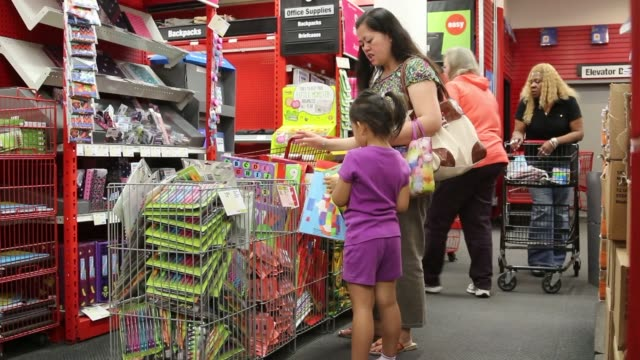 Various shots of back to school shopping at a Staples retail location in Manhattan New York A medium shot of a mother and daughter looking through...