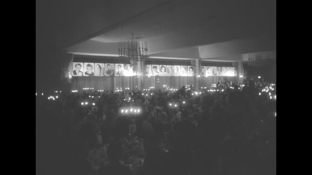 various shots of ballroom with audience at candlelit tables in foreground stage with us map in background photos of movie stars on walls / closer up... - ballroom stock videos & royalty-free footage
