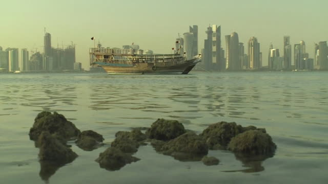 various shots of boats docked and view of qatar skyline - aerial or drone pov or scenics or nature or cityscape stock videos & royalty-free footage